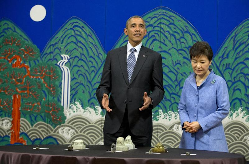 U.S. President Barack Obama speaks in a ceremony with South Korean President Park Geun-hye to return nine ancient seals that an American Marine removed from the country during the Korean War at the Blue House, Friday, April 25, 2014, in Seoul, South Korea. (AP Photo/Carolyn Kaster)