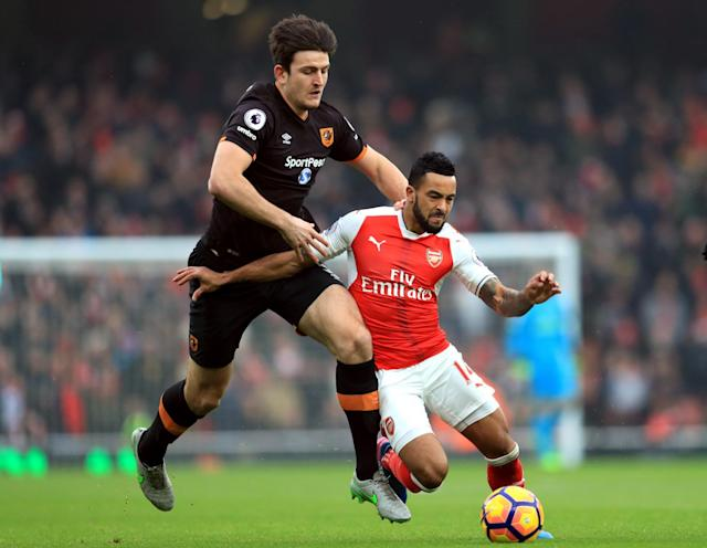 <p>Arsenal's Theo Walcott and Hull City's Harry Maguire (left) </p>