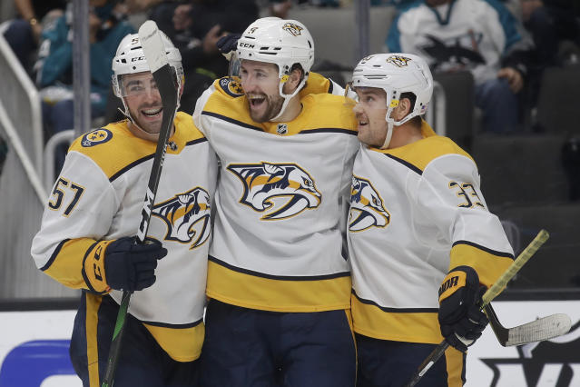 Nashville Predators left wing Filip Forsberg, center, is congratulated by defenseman Dante Fabbro (57) and left wing Viktor Arvidsson (33) after scoring a goal against the San Jose Sharks during the second period of an NHL hockey game in San Jose, Calif., Saturday, Nov. 9, 2019. (AP Photo/Jeff Chiu)