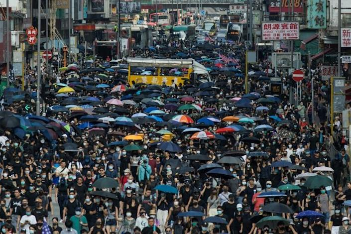 Thousands of people marched through Mong Kok in Hong Kong in defiance of a police ban on the gathering (AFP Photo/Philip FONG)