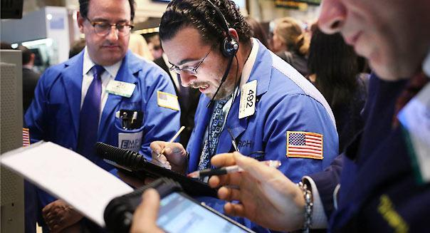 NEW YORK, NY - APRIL 02:  Traders work on the floor of the New York Stock Exchange at the end of the trading day on April 2, 2013 in New York City. The Dow Jones Industrial average and the S&P 500 rose to new record highs on April 2, with the Dow finishing at a record close of 14,662. All three major indexes are up between about 10 percent and 12 precent for the year.  (Photo by Spencer Platt/Getty Images)