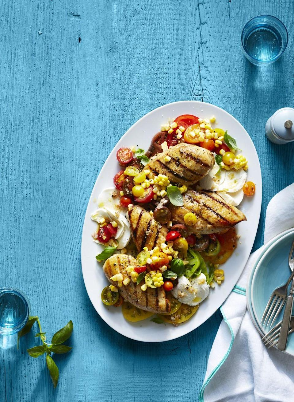 "<p>Chicken is a great way to add filling protein to a Caprese salad.</p><p><a href=""https://www.womansday.com/food-recipes/food-drinks/recipes/a51545/grilled-chicken-caprese/"" rel=""nofollow noopener"" target=""_blank"" data-ylk=""slk:Get the Grilled Chicken Caprese recipe."" class=""link rapid-noclick-resp""><em><strong>Get the Grilled Chicken Caprese recipe.</strong></em></a></p>"