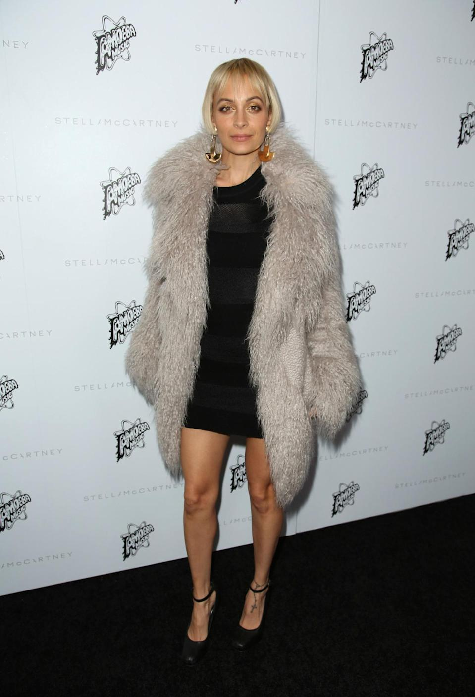 <p>Trust Nicole Richie to look completely fabulous. The former reality star looked as fierce as ever in a LBD with a shaggy overcoat.<i> [Photo: Rex]</i></p>
