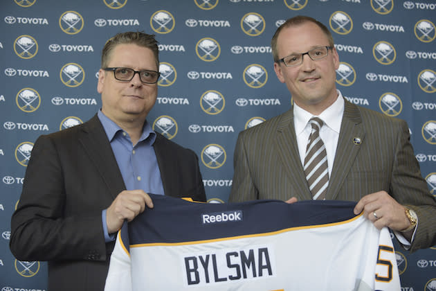 "FILE – In this May 28, 2015, file photo, <a class=""link rapid-noclick-resp"" href=""/nhl/teams/buf/"" data-ylk=""slk:Buffalo Sabres"">Buffalo Sabres</a> GM Tim Murray, left, and newly hired coach Dan Bylsma hold a Sabres' jersey as they pose for a photo after a news conference in Buffalo, N.Y. The Sabres have fired general manager Tim Murray and coach Dan Bylsma after the youthful team missed the playoffs for a sixth consecutive season. Owner Terry Pegula made the announcement Thursday, April 20, 2017. (AP Photo/Gary Wiepert, File)"