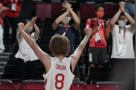 Japan's Maki Takada (8) celebrates with fans after the team's win over Belgium in a women's basketball quarterfinal game at the 2020 Summer Olympics, Wednesday, Aug. 4, 2021, in Saitama, Japan. (AP Photo/Eric Gay)