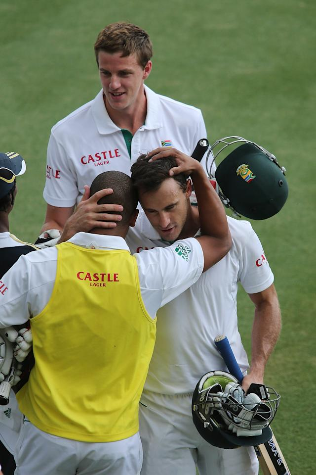 ADELAIDE, AUSTRALIA - NOVEMBER 26:  Faf du Plessis and Morne Morkel of South Africa leaves the field after the end of play day five of the Second Test Match between Australia and South Africa at Adelaide Oval on November 26, 2012 in Adelaide, Australia.  (Photo by Morne de Klerk/Getty Images)