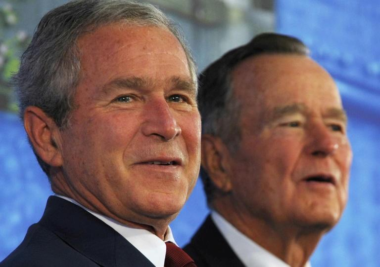 George W. Bush (L) spent eight years in the White House, after his father (R) served one term