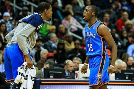Oklahoma City Thunder point guard Reggie Jackson (15) celebrates with small forward Kevin Durant (left) after making a buzzer beater shot to end the third quarter against the Atlanta Hawks at Philips Arena. Mandatory Credit: Daniel Shirey-USA TODAY