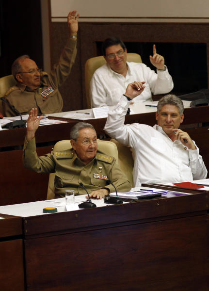 Cuba's President Raul Castro, left, Vice President Miguel Diaz-Canel, right, Cuban Armed Forces Minister Leopoldo Cintras Frias, back left ,and Cuba's Foreign Affairs Minister Bruno Rodriguez vote during the second day of a twice-annual legislative sessions, at the National Assembly in Havana, Cuba, Sunday, July 7, 2013. Observers will be watching to see if the new vice president is taking on increasing responsibility since assuming the post in what was seen as the beginning of a generational leadership transition. (AP Photo/Ismael Francisco, Cubadebate)