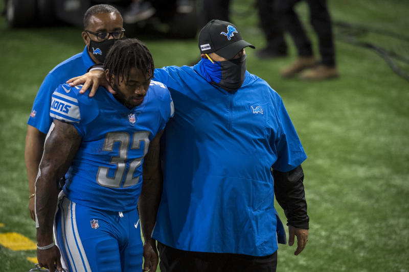 DETROIT, MI - SEPTEMBER 13: D'Andre Swift #32 of the Detroit Lions is comforted by head coach Matt Patricia of the Detroit Lions while walking off the field after the game against the Chicago Bears at Ford Field on September 13, 2020 in Detroit, Michigan. (Photo by Nic Antaya/Getty Images)