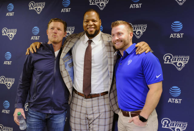 Defensive tackle Ndamukong Suh, center, poses for a photo with Rams coach Sean McVay, right and general manager Les Snead. (AP)