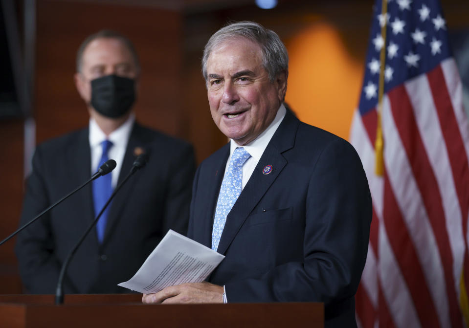 FILE - In this Sept. 21, 2021, file photo House Budget Committee Chair John Yarmuth, D-Ky., joined at left by House Intelligence Committee Chairman Adam Schiff, D-Calif., talks to reporters at the Capitol in Washington. (AP Photo/J. Scott Applewhite, File)