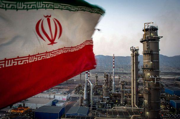 PHOTO: An Iranian national flag flies at the Persian Gulf Star Co. gas condensate refinery in Bandar Abbas, Iran in this Jan. 9. 2019 file photo. (Ali Mohammadi/Bloomberg via Getty Images, FILE)