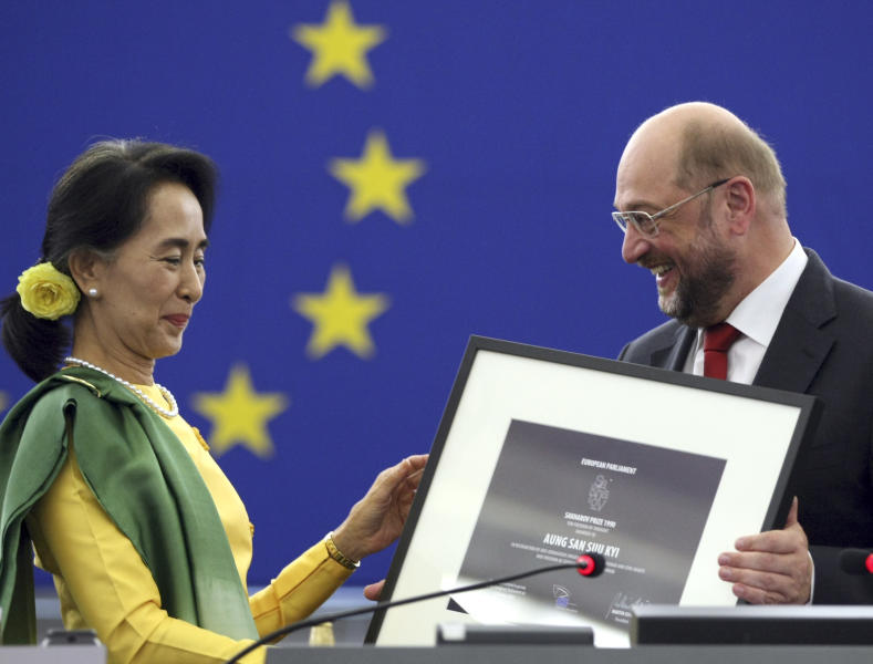 Aung San Suu Kyi, Myanmar's Nobel Peace Prize laureate and long-time political prisoner, finally collects the European Union's 1990 Sakharov Prize for human rights from European Parliament President Martin Schulz at the European parliament in Strasbourg eastern France Tuesday Oct 22, 2013. Suu Kyi has persevered for decades in promoting democracy. She and her National League for Democracy party were frozen out of politics by the military regime that governed until 2011, and last year she and several dozen party members won parliamentary seats. (AP Photo/Christian Lutz)