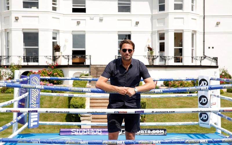 Promoter Eddie Hearn poses for a photograph in a ring at the Matchroom HQ - Action Images via Reuters/Andrew Couldridge