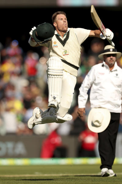 Australia's David Warner celebrates his 300 during their cricket test match against Pakistan in Adelaide, Saturday, Nov. 30, 2019. (AP Photo/James Elsby)