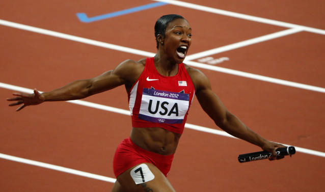 Carmelita Jeter of the U.S. celebrates after the U.S. won the women's 4x100m relay final during the London 2012 Olympic Games at the Olympic Stadium August 10, 2012. The United States won the women's 4x100 metres relay in a world record time at the London Olympics on Friday, completing the lap in a sizzling 40.82 seconds to win the title back for the first time since 1996. REUTERS/David Gray (BRITAIN - Tags: OLYMPICS SPORT ATHLETICS)