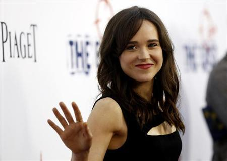 "Cast member Ellen Page waves at the premiere of ""The East"" at the Arclight theatre in Hollywood, California May 28, 2013. REUTERS/Mario Anzuoni/Files"