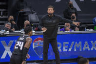 Sacramento Kings Luke Walton, coaches Sacramento Kings guard Buddy Hield (24) during the second quarter of of an NBA basketball game against the Los Angeles Lakers in Sacramento, Calif., Wednesday, March 3, 2021. (AP Photo/Hector Amezcua)