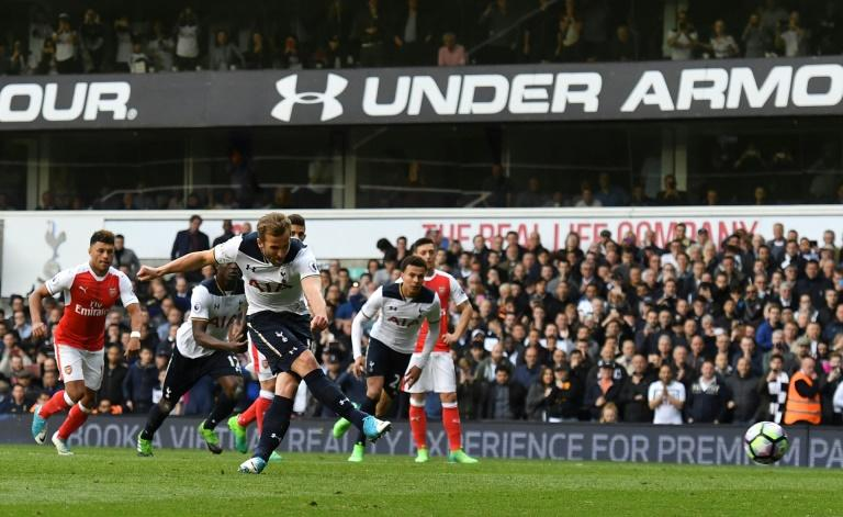 Tottenham Hotspur's striker Harry Kane (C) takes the penalty to score on April 30, 2017
