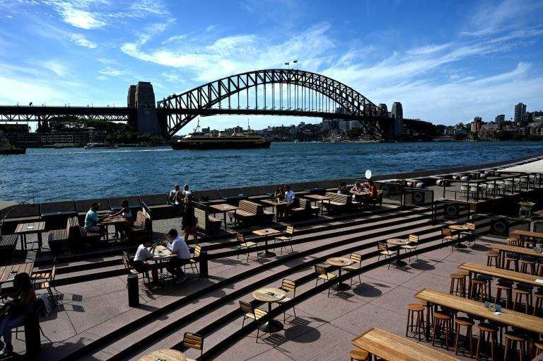 Restaurants along Sydney Harbour are usually packed with locals and tourists on Christmas Eve but are now quiet due to Covid-19 concerns