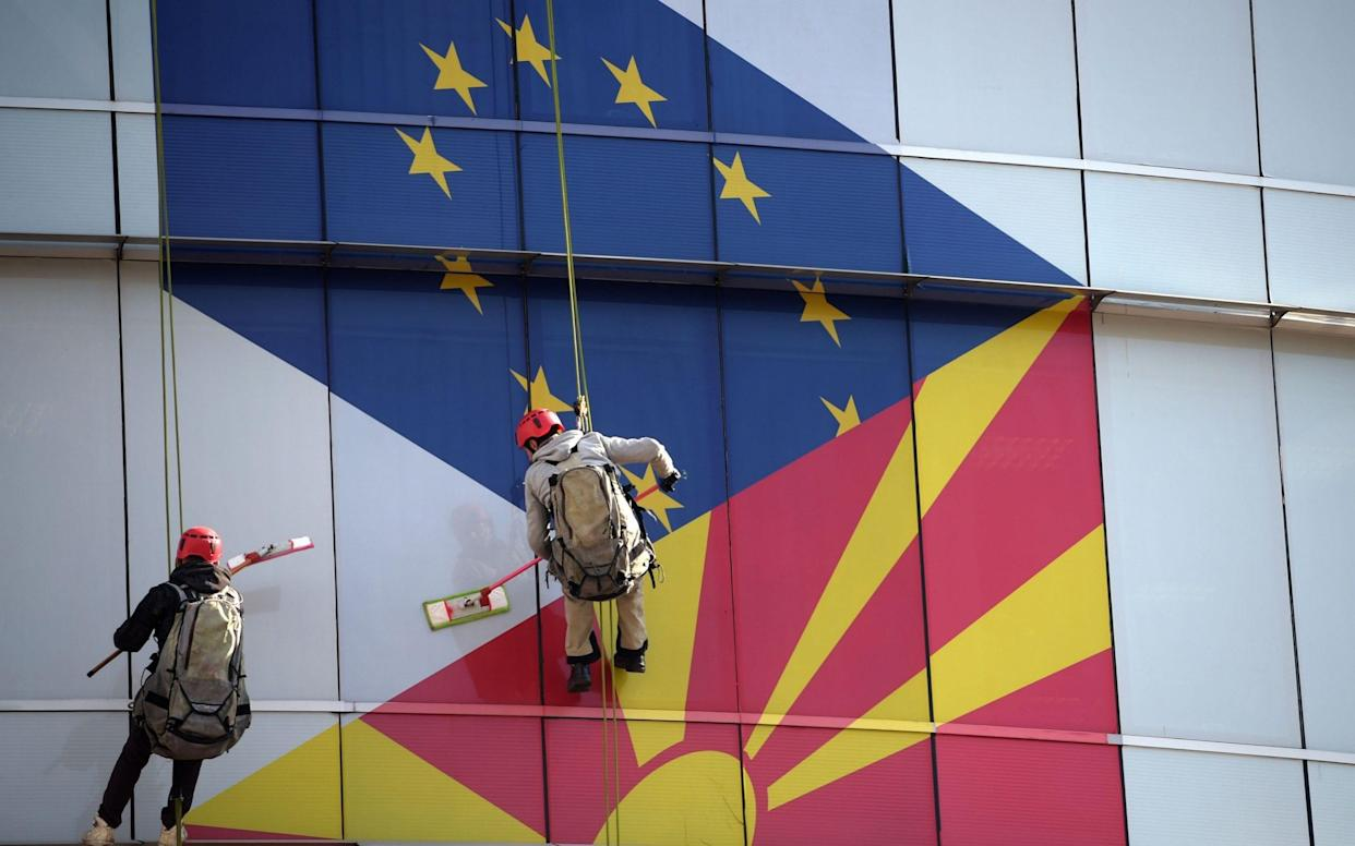 The European Union and Macedonian flags decorate the windows of the EU office in Skopje, North Macedonia - REX