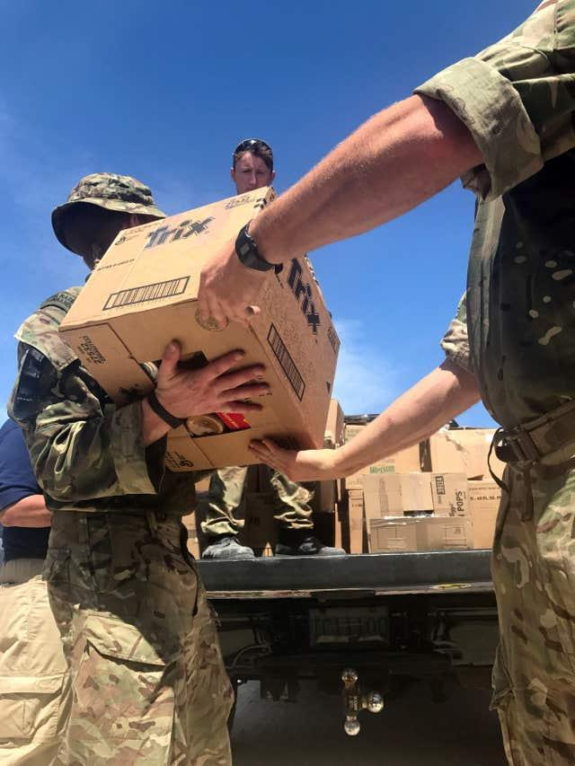 British troops deliver aid on Grand Turk in the Turks and Caicos Islands, a British overseas territory affected by the wrath of Hurricane Irma (Georgina Stubbs/PA)