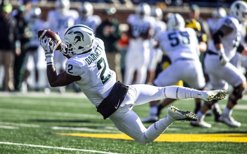 FILE - In this Nov. 16, 2019, file photo, Michigan State wide receiver Julian Barnett (2) makes a catch in the first quarter of an NCAA college football game against Michigan in Ann Arbor, Mich. Big Ten is going to give fall football a shot after all. Less than five weeks after pushing football and other fall sports to spring in the name of player safety during the pandemic, the conference changed course Wednesday, Sept. 16, 2020, and said it plans to begin its season the weekend of Oct. 23-24. (AP Photo/Tony Ding)