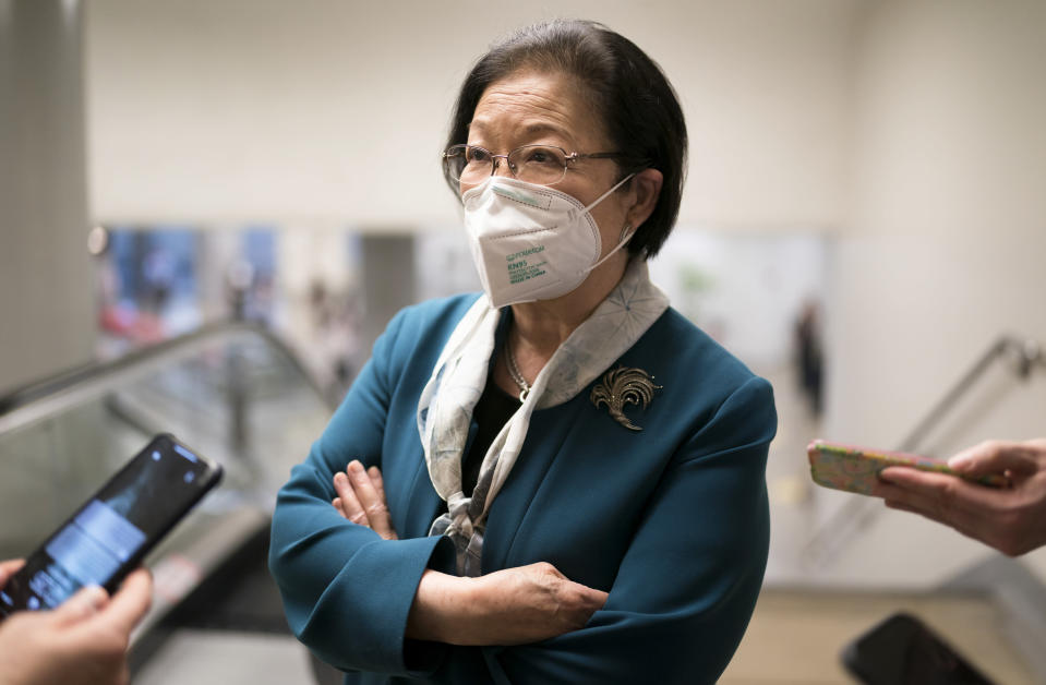 Sen. Mazie Hirono, D-Hawaii, pauses for reporters as senators head to the chamber for a procedural vote on the nomination of Shalanda Young to be deputy director of the Office of Management and Budget, at the Capitol in Washington, Tuesday, March 23, 2021. (AP Photo/J. Scott Applewhite)