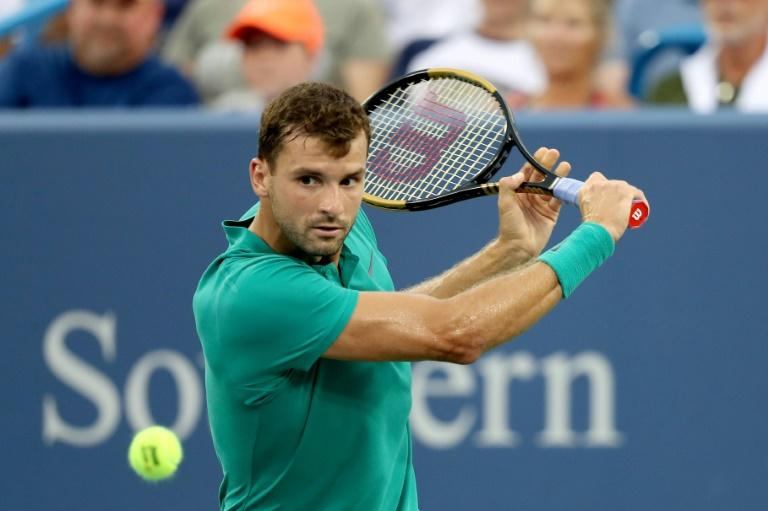 Grigor Dimitrov of Bulgaria returns a shot to Novak Djokovic of Serbia during the Western & Southern Open, at Lindner Family Tennis Center in Mason, Ohio, on August 16, 2018