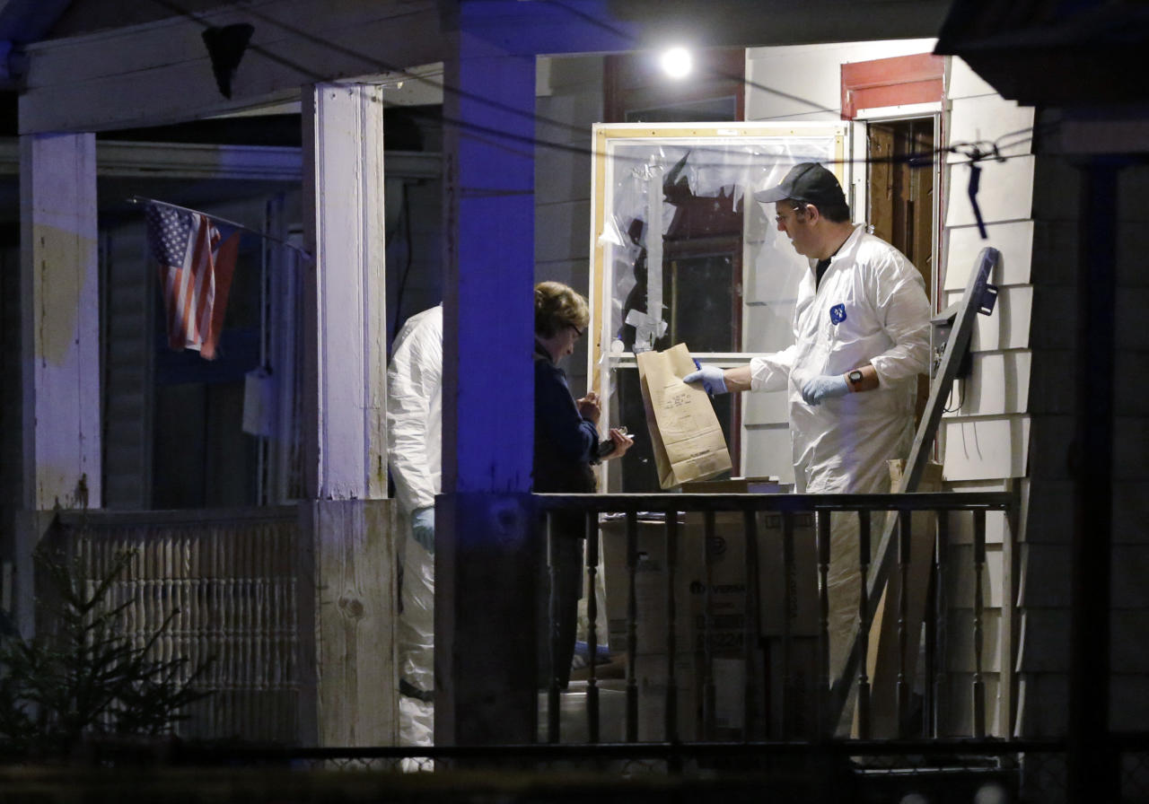 Members of the FBI evidence team remove items from a house on in Cleveland Monday, May 6, 2013. Three women who went missing separately about a decade ago, when they were in their teens or early 20s, were found alive in the house, and a man was arrested. (AP Photo/Mark Duncan)