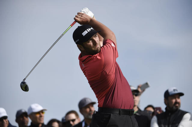 John Rahm of Spain hits his tee shot on the second hole of the South Course at Torrey Pines Golf Course during the second round of the Farmers Insurance golf tournament Friday Jan. 24, 2020, in San Diego. (AP Photo/Denis Poroy)