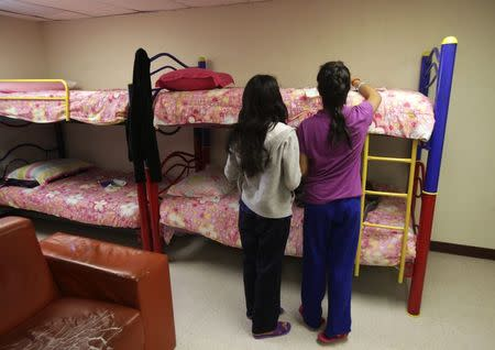 """Girls stand in a dorm at the shelter for underage immigrants and repatriated minors """"Mexico, my home"""" in Ciudad Juarez May 27, 2014. REUTERS/Jose Luis Gonzalez"""