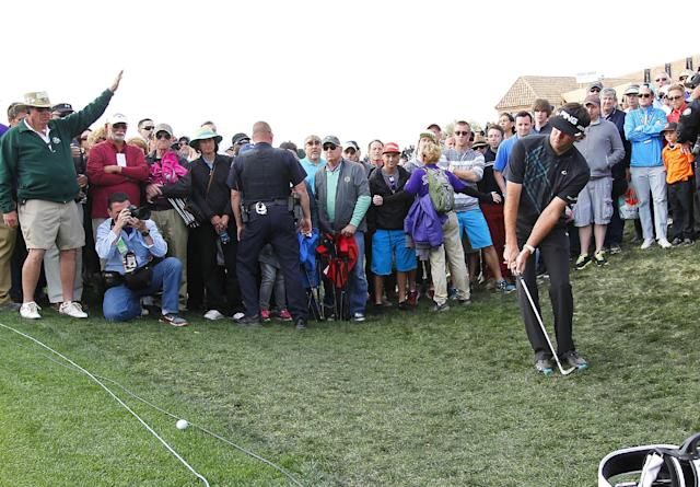 Bubba Watson hits from the rough behind the green on the 18th hole during the final round of the Phoenix Open golf tournament on Sunday, Feb. 2, 2014, in Scottsdale, Ariz. (AP Photo/Ross D. Franklin)
