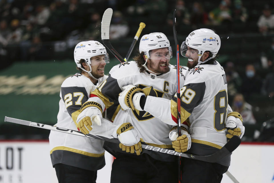 Vegas Golden Knights' Mark Stone (61) celebrates with teammates after scoring a goal against the Minnesota Wild during the second period in Game 3 of a first-round NHL hockey playoff series Thursday, May 20, 2021, in St. Paul, Minn. (AP Photo/Stacy Bengs)