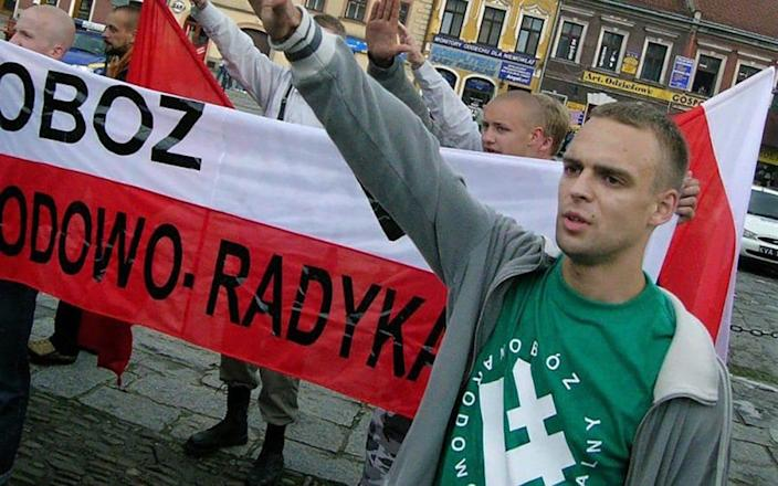 Tomasz Greniusz performing a Nazi-style salute at party rallies in 2005-07 - Social media