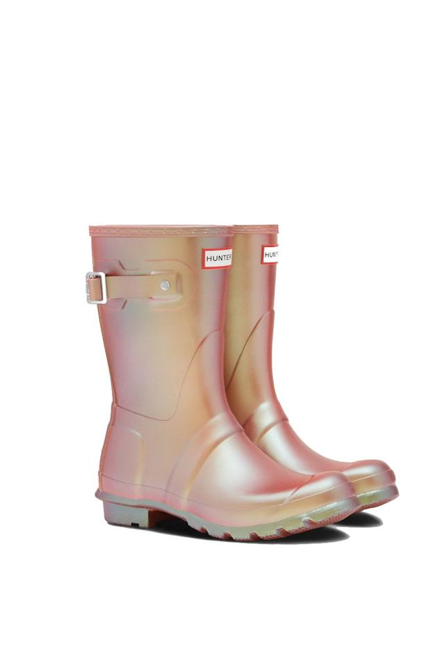 "<p><strong>Hunter Boots</strong></p><p>hunterboots.com</p><p><strong>$150.00</strong></p><p><a href=""https://www.hunterboots.com/us/en_us/womens-short-rain-boots/womens-original-nebula-short-rain-boots/pink/5214"" target=""_blank"">SHOP IT</a></p><p>On the off-chance it rains, you'll be equipped with these iridescent boots from Hunter. Depending on how the light hits them, you'll see reflections of pink, yellow, gold, and maybe even green. These mermaid-like hues are sure to brighten up your summer day even if the sun decides not to show.</p>"