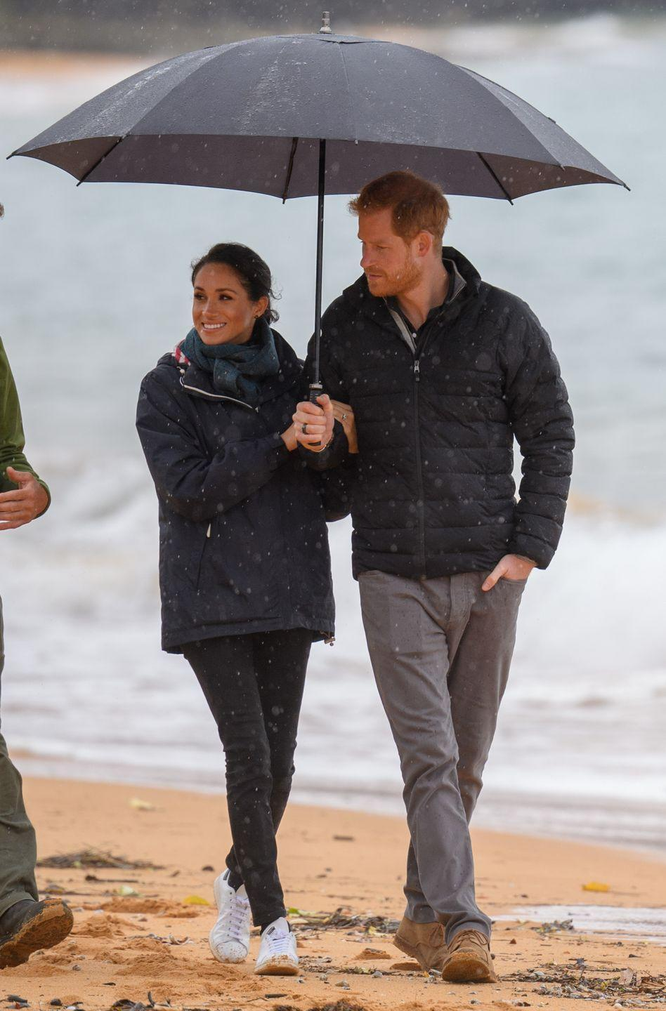 """<p>The Duke and Duchess visited Abel Tasman National Park, where they learned about conservation programs. Both Harry and Meghan bundled up for the stormy weather, with Meghan wearing a coat and scarf over with <a href=""""https://outlanddenim.ca/products/harriet-in-black-1?variant=12431424815201"""" rel=""""nofollow noopener"""" target=""""_blank"""" data-ylk=""""slk:Outland Denim's Harriet jeans."""" class=""""link rapid-noclick-resp"""">Outland Denim's Harriet jeans.</a> According to <a href=""""http://meghansmirror.com/royal-style/royal-tours/royal-tour-australia/meghan-harry-travel-to-abel-tasman-park/"""" rel=""""nofollow noopener"""" target=""""_blank"""" data-ylk=""""slk:Meghan's Mirror,"""" class=""""link rapid-noclick-resp"""">Meghan's Mirror,</a> the Duchess also wore Stella McCartney x Adidas """"Stan Smith"""" collaboration sneaker. </p><p><a class=""""link rapid-noclick-resp"""" href=""""https://go.redirectingat.com?id=74968X1596630&url=https%3A%2F%2Fwww.bergdorfgoodman.com%2FStella-McCartney-Stan-Smith-Collab-Sneakers%2Fprod140020073%2Fp.prod&sref=https%3A%2F%2Fwww.townandcountrymag.com%2Fstyle%2Ffashion-trends%2Fg3272%2Fmeghan-markle-preppy-style%2F"""" rel=""""nofollow noopener"""" target=""""_blank"""" data-ylk=""""slk:SHOP NOW"""">SHOP NOW</a> <em>Stella McCartney x Adidas Stan Smith sneaker, $325</em></p>"""
