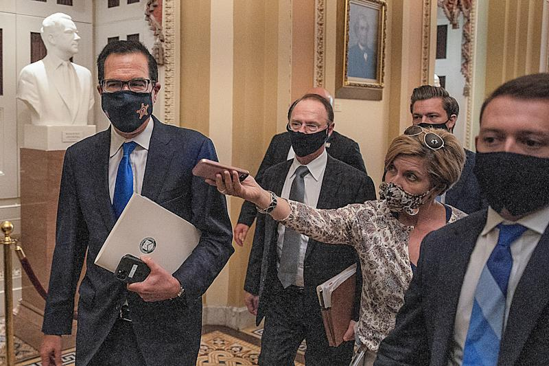 Treasury Secretary Steven Mnuchin departs from the office of Senate Majority Leader Mitch McConnell at the U.S. Capitol on Wednesday. Mnuchin met with Democrats and Republicans about coronavirus relief legislation. (Photo: Tasos Katopodis via Getty Images)