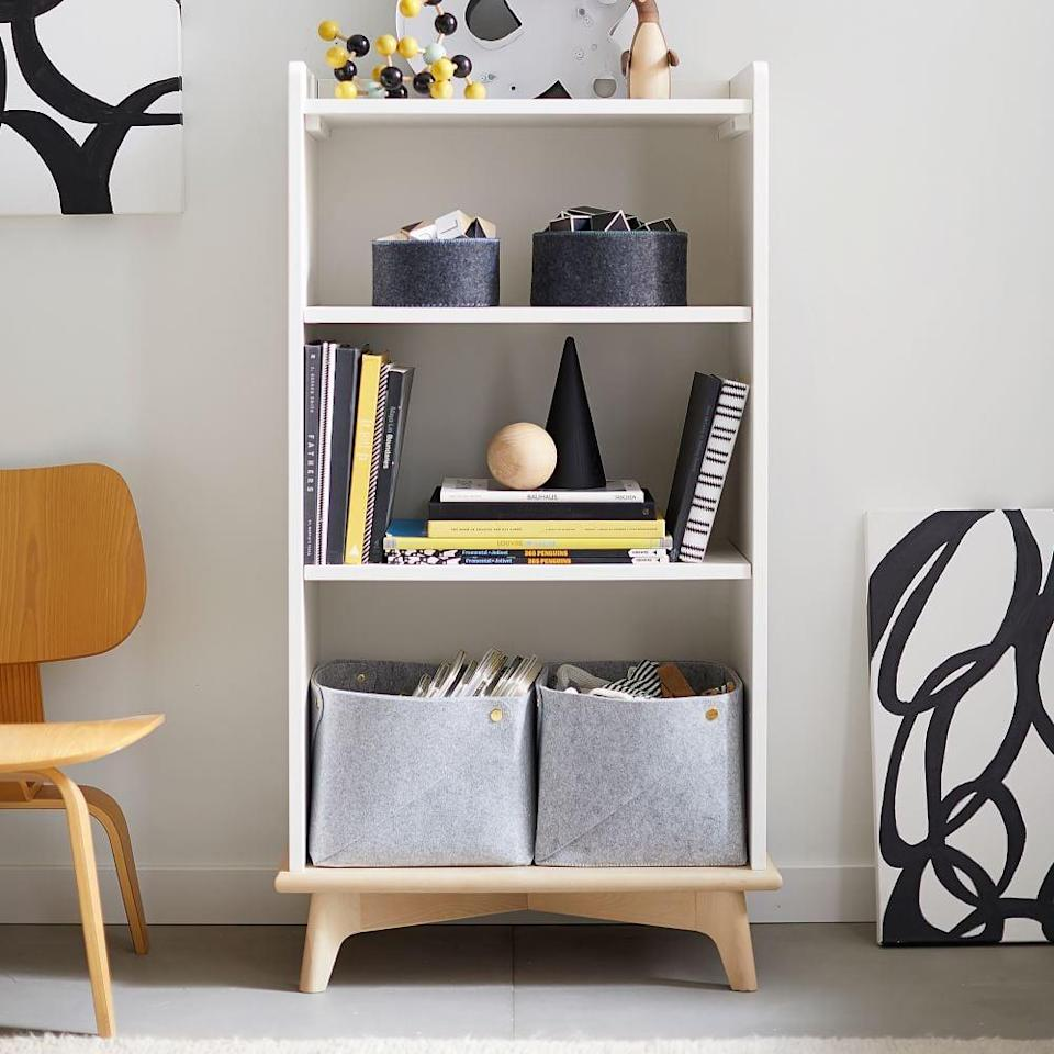 <p>If you need a useful piece of furniture, go with this <span>West Elm Sloan Tall Bookcase</span> ($299).</p>
