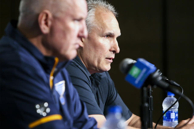 St. Louis Blues NHL hockey team head coach Craig Berube, rear, and general manager Doug Armstrong speak during a press conference in St. Louis, Wednesday, June 26, 2019. Berube, who led the franchise to its first Stanley Cup title this season, signed a three year contract with the team on Tuesday, officially removing his interim title. (Colter Peterson/St. Louis Post-Dispatch via AP)