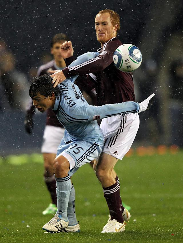 KANSAS CITY, KS - NOVEMBER 02: Jeff Larentowicz #4 of the Colorado Rapids battles Roger Espinoza #15 of Sporting Kansas City for the ball during the MLS playoff game on November 2, 2011 at LiveStrong Sporting Park in Kansas City, Kansas. (Photo by Jamie Squire/Getty Images)