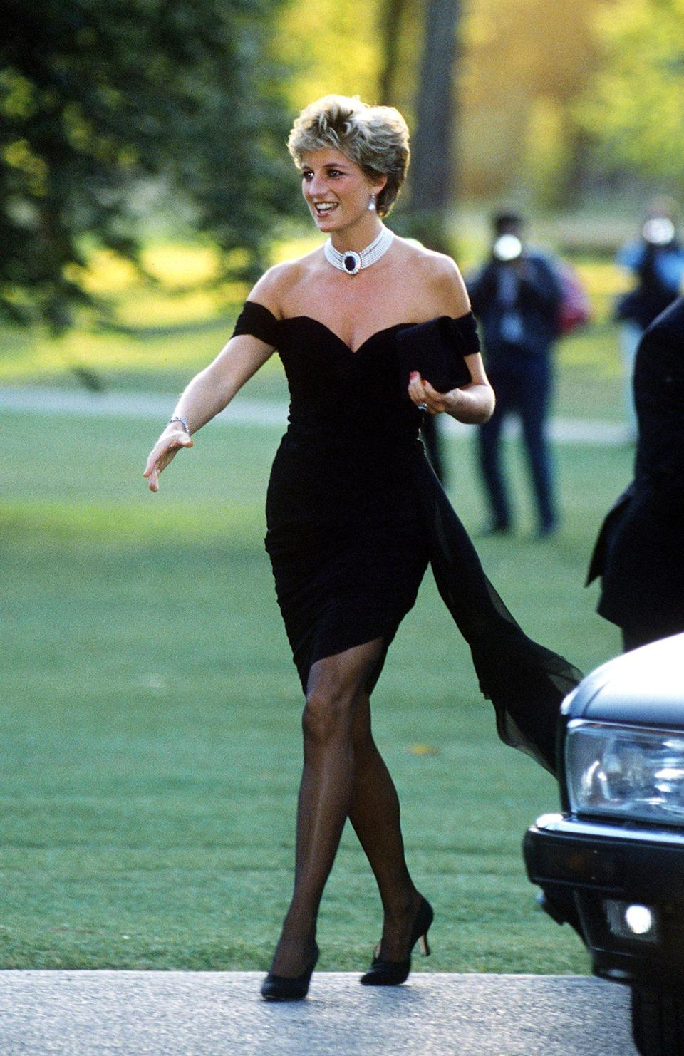 """<p>Jayne Fincher snapped this iconic photo of Princess Diana in her <a href=""""https://people.com/royals/princess-diana-revenge-dress-true-story/"""" rel=""""nofollow noopener"""" target=""""_blank"""" data-ylk=""""slk:&quot;revenge dress&quot;"""" class=""""link rapid-noclick-resp"""">""""revenge dress""""</a>, which she wore in June 1994, the same day that Prince Charles publicly admitted that he had been unfaithful to her. </p>"""