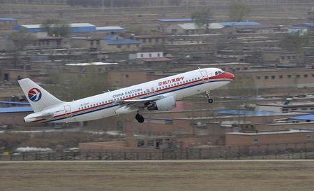 A China Eastern Airlines plane takes off at an airport in Taiyuan