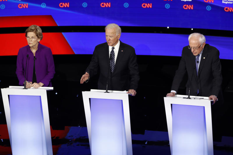 Democratic presidential candidate former Vice President Joe Biden answers a question Tuesday, Jan. 14, 2020, during a Democratic presidential primary debate hosted by CNN and the Des Moines Register in Des Moines, Iowa, as Sen. Elizabeth Warren, D-Mass., left and Sen. Bernie Sanders, I-Vt., listen. (AP Photo/Patrick Semansky)