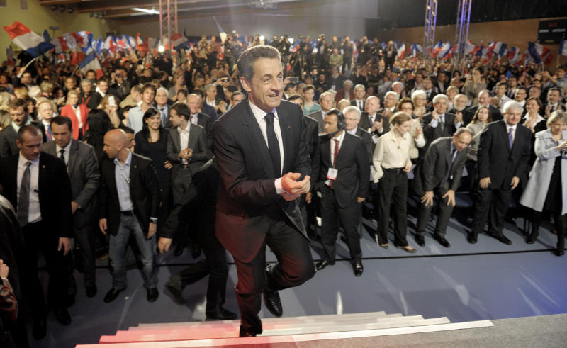 French President and conservative candidate for the 2012 French presidential elections Nicolas Sarkozy arrives on the stage to deliver a speech at a political campaign rally in Le Raincy, near Paris, Thursday, April 26, 2012. (AP Photo/Philippe Wojazer,Pool)