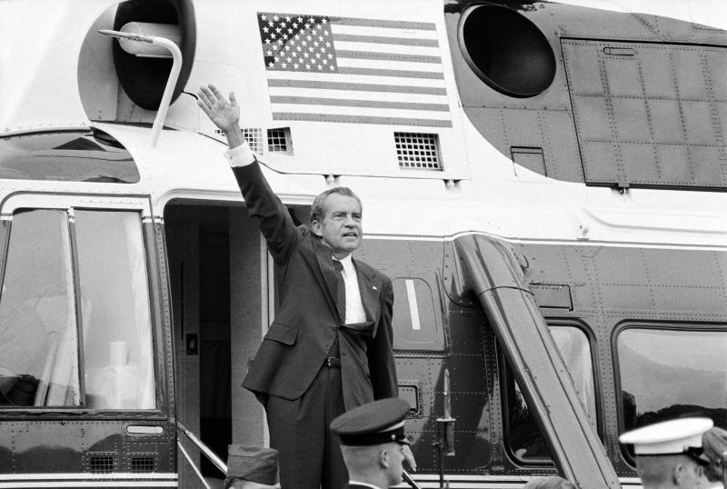 President Nixon waves goodbye from the steps of his helicopter outside the White House Aug. 9, 1974, after he gave a farewell address to members of the White House staff. (Photo: Chick Harrity/AP)