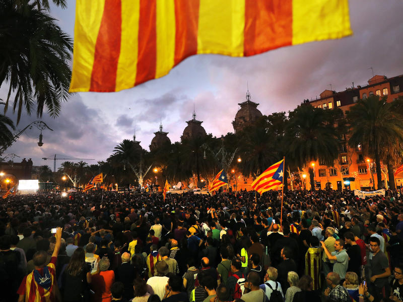 Thousands gathered to listen to Catalan President Carles Puigdemont in the regional Parliament in Barcelona: EPA
