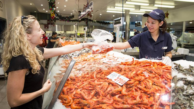 customers buying prawns at the sydney seafood market