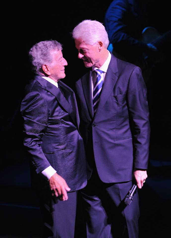 NEW YORK, NY - SEPTEMBER 18:  Tony Bennett (L) and former President of the United States Bill Clinton greet onstage during Tony Bennett's 85th Birthday Gala Benefit for Exploring the Arts at The Metropolitan Opera House on September 18, 2011 in New York City.  (Photo by Larry Busacca/Getty Images)
